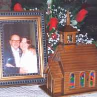 A framed photo of Barbara Womer and her dad beside the special music box.