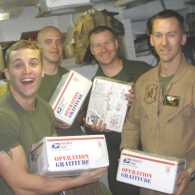 Photo of troops happily receiving care packages from Operation Rescue