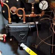 The controls of an old basement furnace