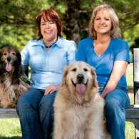 Peggy Frezon with her spaniel, Kelly, and Kathy with her golden, Moses