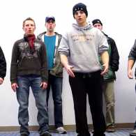 An a capella group known as Face performs at DFW airport.