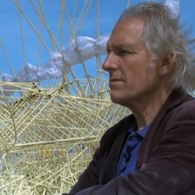 Artist Theo Jansen in front of his kinetic sculpture