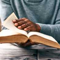Man flipping the pages of a bible