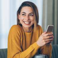 Woman smiles at phone