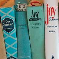 Several editions of the Joy of Cooking cookbook