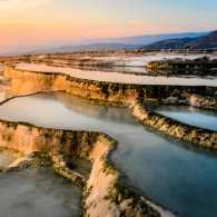 Carbonate travertines the natural pools during sunset, Pamukkale, Turkey