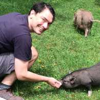 Guideposts staffer Doug Snyder pets one of his porcine pals at Pennsylvania's Ross Mills Farm