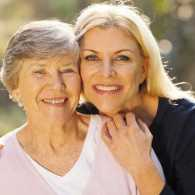Guideposts: A smiling embraces her senior mother.