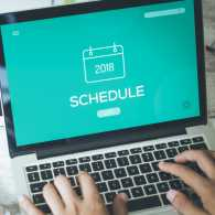 A person setting a task on an online calendar schedule.