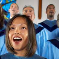 A choir sings joyfully