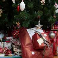 Colorful Christmas gifts underneath a Christmas tree.