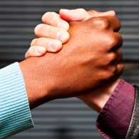 Guideposts: Two men's hands clasp in a show of support and strength