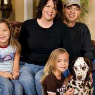 Ginger with the Collin's family in their home.
