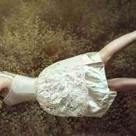 Guideposts: A dreaming woman floats in the air