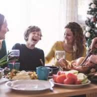 A happy family around the dinner table during the holiday season.