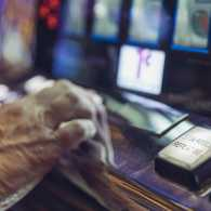 A woman plays a slot machine
