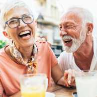 A mature woman and man enjoy a laugh together