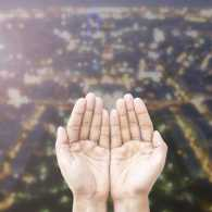 Hands open in prayer for the upcoming New Year.