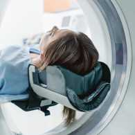A woman undergoes an MRI examination