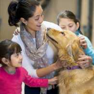 Woman and her young children at a dog shelter