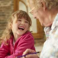 A retired woman helps with child care.