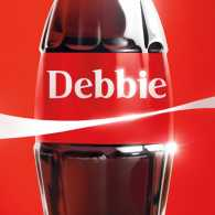 A vintage glass Coke bottle with 'Debbie' on the label.