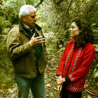Jacqueline Suskin having a conversation with Neal in the forest.