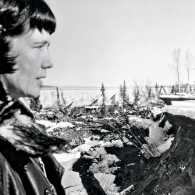 Tay Thomas surveys damage caused by the March 27, 1964, Good Friday earthquake