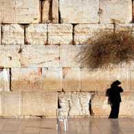 A person prays at the Western Wall