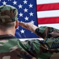 Guideposts: A soldier in fatigues salutes the flag.