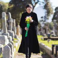 Grieving woman at a cemetery
