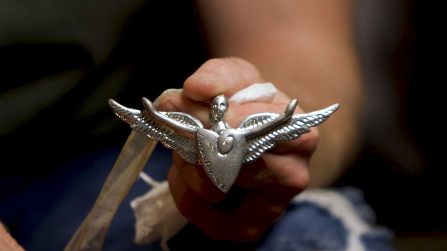 The angel charm Micah Herndon received from his mother