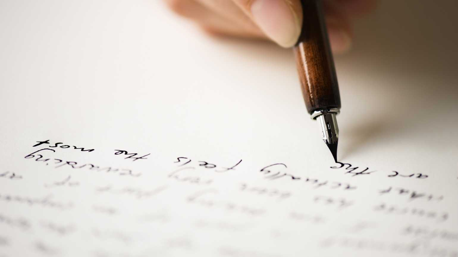 A man writing a letter.