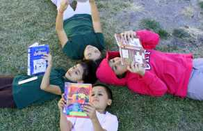 Children reading as part of U.S. Dream Academy's Read to Achieve Read-a-thon