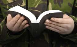 Soldier praying (Thinkstock)