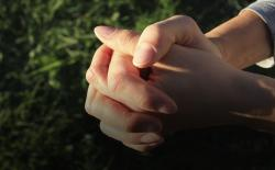 Hands clasped in prayer. Thinkstock.