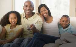 Family watching TV. (Thinkstock)