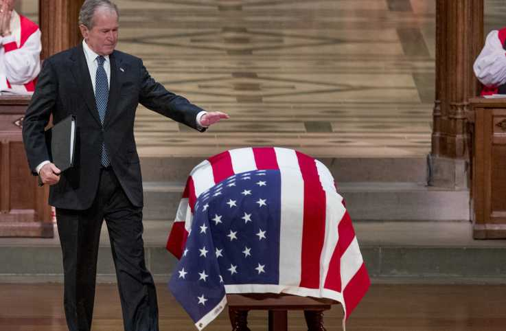 George W. Bush saying goodbye to his father, George H.W. Bush