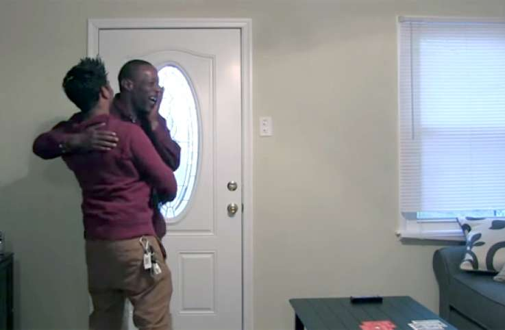 Rahat Hossain and his friend Eric hug after Eric learns he has a new home.