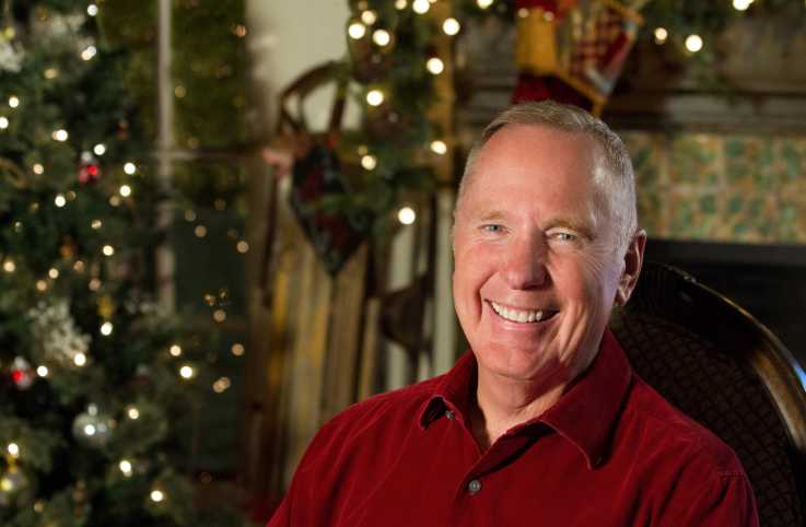 Max Lucado with a holiday decor background