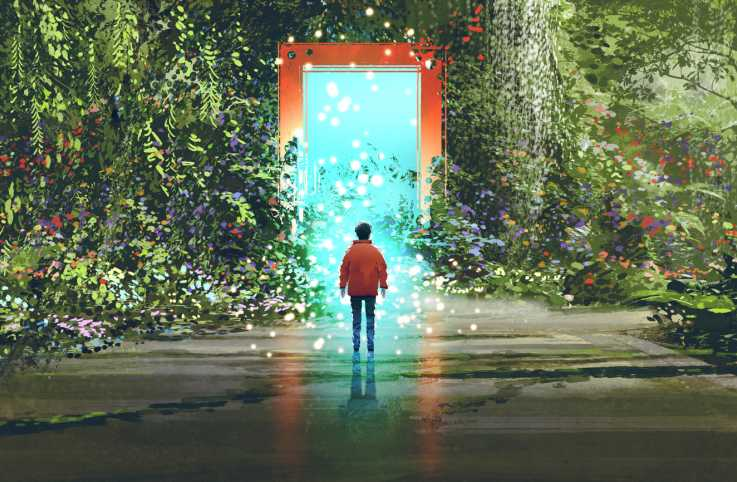 Boy standing in front of a magic gate.