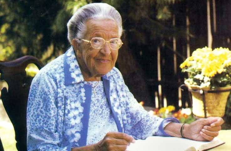 A portrait of Corrie ten Boom sitting outside on a warm day.