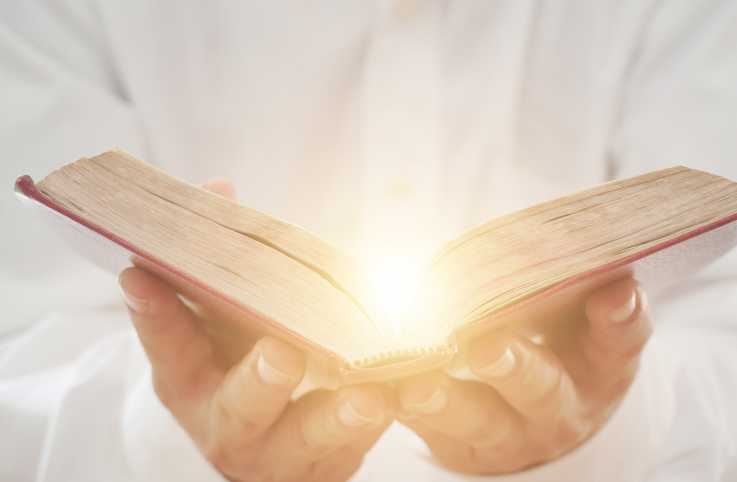 Man holding an open Bible