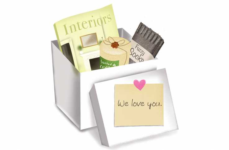"A box full of care items and a note that says ""we love you"" attached to the lid."