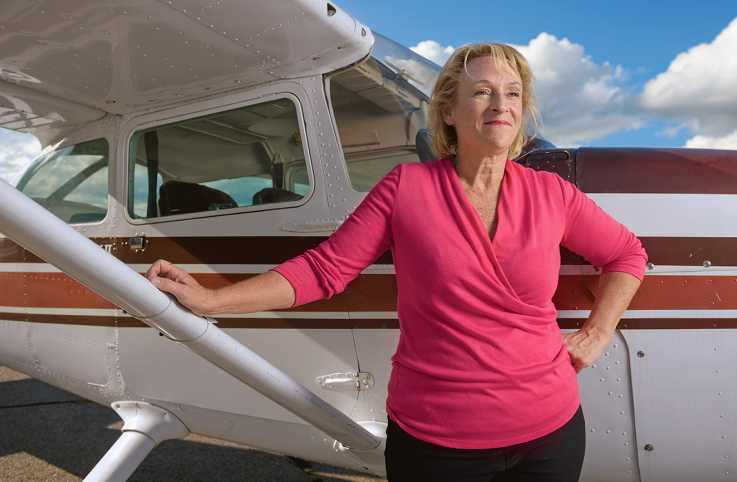Cathy Lewan, a second-generation flyer, poses with her Cessna