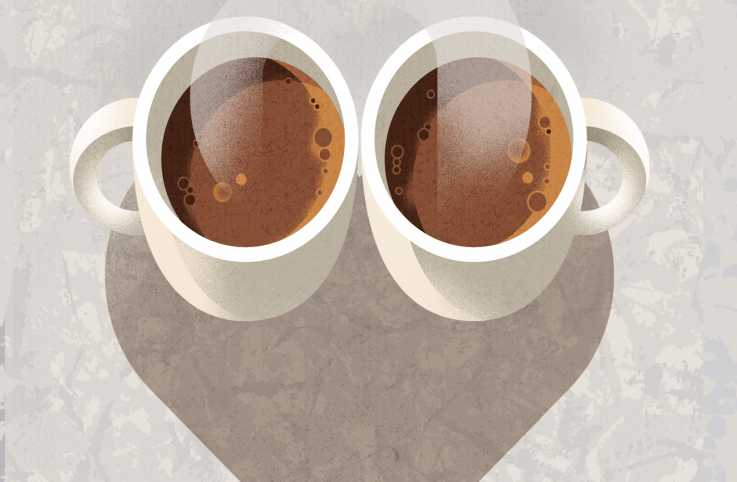 Two steaming coffee cups with their shadows forming a heart.