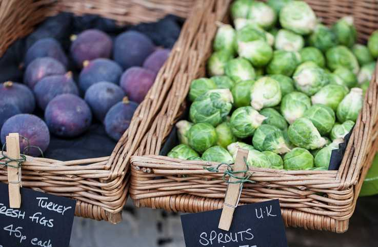 Fresh figs and sprouts at a farmer's market