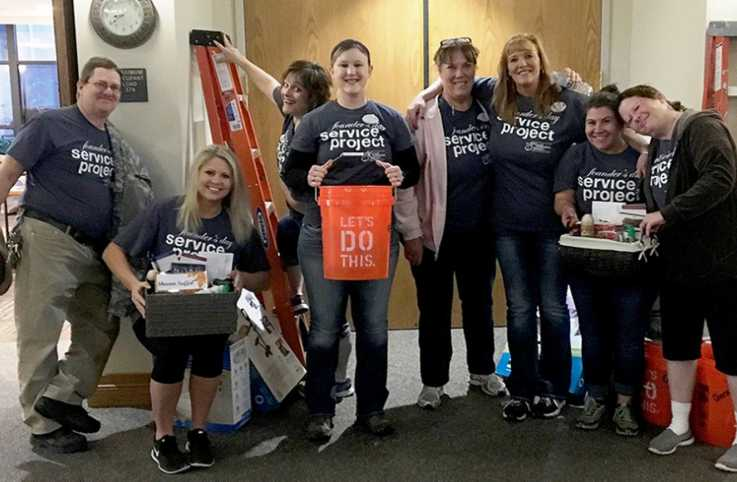 Staff members prepare for the Founder's Day Service Project day. Pictured are Dave Crowley, Courtney Hughbanks, Mimi Wahlfeldt, Kirsten Stockton, Karen Scott, Tammy Fasold, Kayla Sargent and Lori Grant.