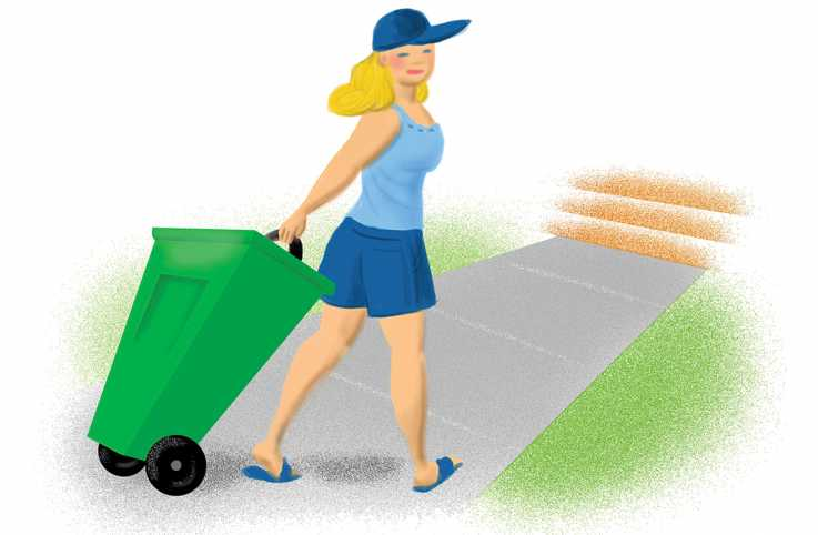 A woman walks on the path to take out a large garbage bin for her neighbor.