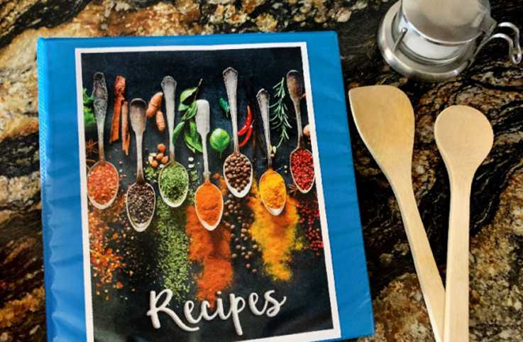 A recipe book with various utensils and ingredients.